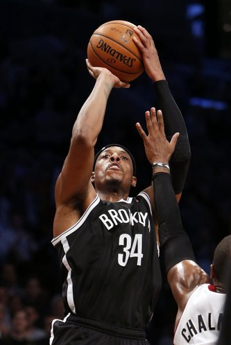Brooklyn Nets' Paul Pierce (34) shoots against Miami Heat's Mario Chalmers during an NBA basketball game Friday, Nov. 1, 2013, in New York. Brooklyn won 101-100. (AP Photo/Jason DeCrow)