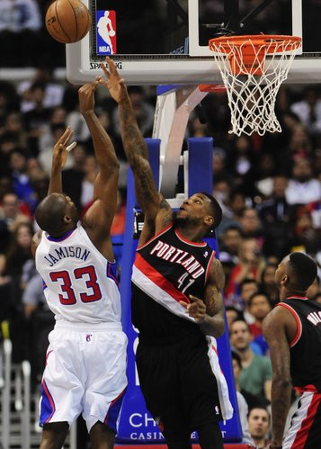 Los Angeles Clippers forward Antawn Jamison (33) shoots over Portland Trail Blazers forward Thomas Robinson (41) in the first half of a pre-season NBA basketball game, Friday, Oct. 18, 2013, in Los Angeles.(AP Photo/Gus Ruelas)