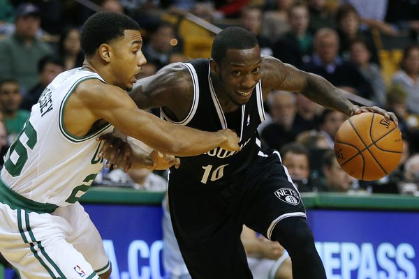 Brooklyn Nets' Tyshawn Taylor (10) drives past Boston Celtics' Phil Pressey (26) in the fourth quarter of a preseason NBA basketball game in Boston, Wednesday, Oct. 23, 2013. The Celtics won 101-97. (AP Photo/Michael Dwyer)