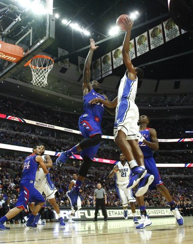 Kansas forward Jamari Traylor gets up to block a shot by Duke forward Rodney Hood during the first half of the Champions Classic matchup on Tuesday, Nov. 12, 2013 at the United Center in Chicago.