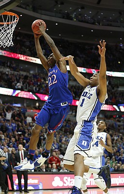 Kansas forward Andrew Wiggins soars in for a dunk past Duke forward Jabari Parker for a dunk late in the second half of the Champions Classic matchup on Tuesday, Nov. 12, 2013 at the United Center in Chicago.