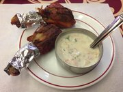 Tandoori chicken appetizer and raita (yogurt-based sauce).
