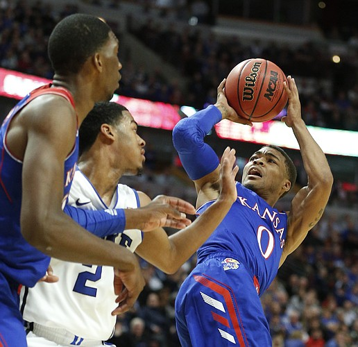 Kansas guard Frank Mason hangs for a shot against Duke during the second half of the Champions Classic matchup on Tuesday, Nov. 12, 2013 at the United Center in Chicago.