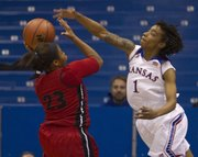 Kansas' Lamaria Cole (1) defends against Southern Illinois-Edwardsville's Alexis Chappelle (23) during their game Wednesday at Allen Fieldhouse.