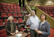 From left Vicki Douglas, Bob Newton, sound designer for productions at Theatre Lawrence, and Mary Doveton, Theatre Lawrence director, discuss the new hearing induction loop, and locate suspended microphones above the stage at the theatre. The new audio system allows those with hearing loss to use headsets and pick up the performance through their hearing aids and cochlear implants.