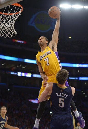 Los Angeles Lakers forward Xavier Henry, top, goes up for a dunk as New Orleans Pelicans center Jeff Withey defends during the second half of an NBA basketball game, Tuesday, Nov. 12, 2013, in Los Angeles. (AP Photo/Mark J. Terrill)