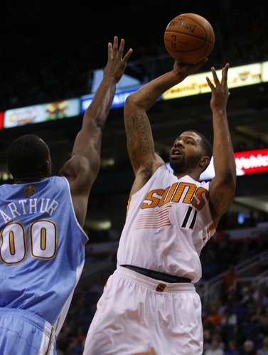 Phoenix Suns power forward Markieff Morris (11), right, scores over the top of Denver Nuggets power forward Darrell Arthur (00) in the third quarter during an NBA basketball game on Friday, Nov. 8, 2013, in Phoenix. The Suns defeated the Nuggets 114-93. (AP Photo/Rick Scuteri)