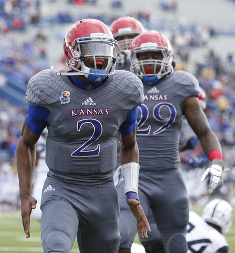 Kansas quarterback Montell Cozart roars after a run against West Virginia during the first quarter on Saturday, Nov. 16, 2013 at Memorial Stadium.