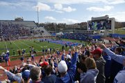 Kansas fans wave the wheat following a James Sims touchdown against West Virginia during the second quarter on Saturday, Nov. 16, 2013 at Memorial Stadium.