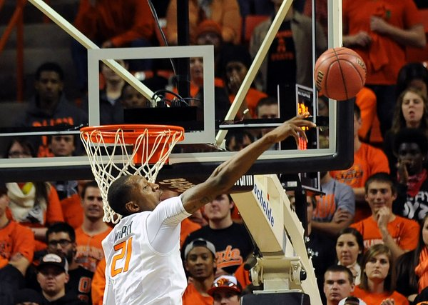 Oklahoma State post Kamari Murphy blocks a Memphis shot during the first half of an NCAA college basketball game in Stillwater, Okla., Tuesday, Nov. 19, 2013.  (AP Photo/Brody Schmidt)