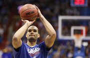 Kansas forward Perry Ellis puts up a shot prior to tipoff against Iona on Tuesday, Nov. 19, 2013 at Allen Fieldhouse.