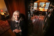 Shelley Hickman Clark sits in the oldest part of her home, built in 1855 by Joseph Savage, one of the city's earliest settlers. The home, at 1734 Kent Terrace, has undergone additions and renovations and is believed by many to be the oldest home in Lawrence.