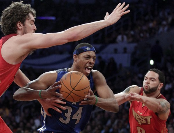 East's Paul Pierce, of the Boston Celtics, drives between West's Deron Williams, right, of the Utah Jazz, and Pau Gasol, of the Los Angeles Lakers, during the second half of the NBA basketball All-Star Game on Sunday, Feb. 20, 2011, in Los Angeles. (AP Photo/Jae C. Hong)