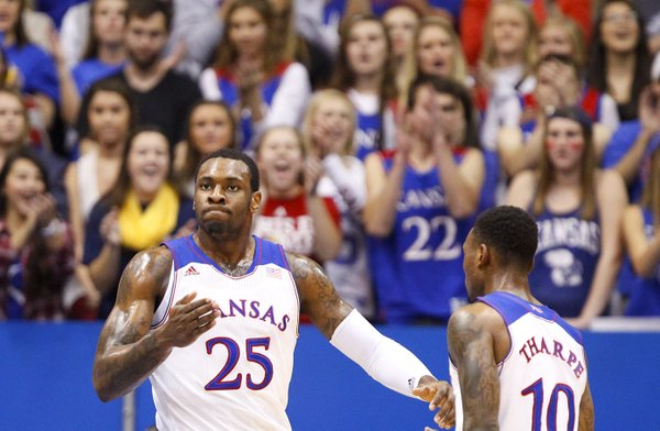 Kansas forward Tarik Black pounds his chest next to teammate Naadir Tharpe after a dunk against Towson during the first half on Friday, Nov. 22, 2013 at Allen Fieldhouse.