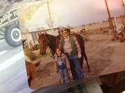 In one of Richard Fraser's many snapshots from years gone by, he's pictured with one of his grandchildren and Sky King, the horse he once rode into Johnny's Tavern.