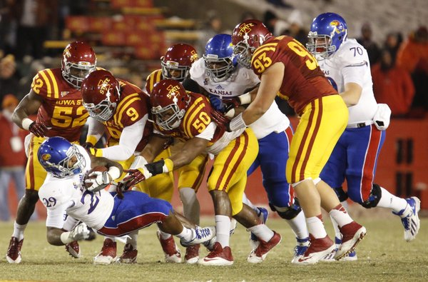 Iowa State defenders collapse around James Sims during the first quarter on Saturday, Nov. 23, 2013 at Jack Trice Stadium in Ames, Iowa.
