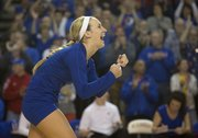 Kansas senior Brianne Riley lets out a yell as she celebrates a point during Kansas' volleyball match against Texas Tech, Saturday at the Horejsi Center. With the 3-0 victory, the Jayhawks gave its seven seniors a win in their final game in the Horejsi Center. The Jayhawks will next face Denver at home on Tuesday, but that game is being played at Allen Fieldhouse.