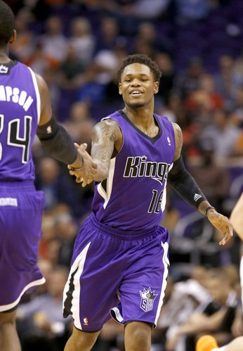 Sacramento Kings' Ben McLemore (16) shakes hands with teammate Jason Thompson during the second half of an NBA basketball game against the Phoenix Suns, Wednesday, Nov. 20, 2013, in Phoenix. The Kings won 113-106. (AP Photo/Ross D. Franklin)