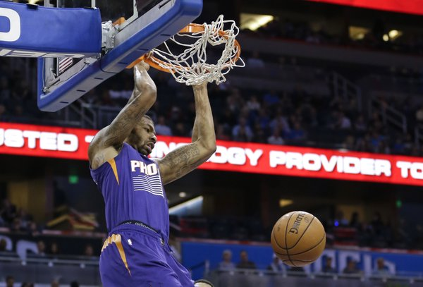 Phoenix Suns' Markieff Morris dunks the ball against the Orlando Magic during the first half of an NBA basketball game in Orlando, Fla., Sunday, Nov. 24, 2013.(AP Photo/John Raoux)