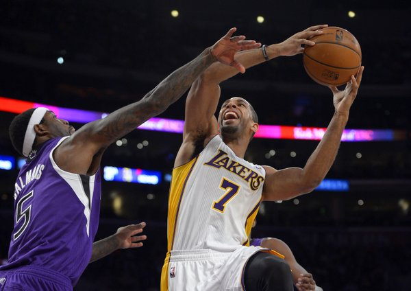 Los Angeles Lakers forward Xavier Henry, right, puts up a shot as Sacramento Kings forward John Salmons defends during the first half of an NBA basketball game Sunday, Nov. 24, 2013, in Los Angeles. (AP Photo/Mark J. Terrill)