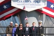 U.S. Navy Capt. Sean Bailey, at right, a Kansas University graduate, is executive officer of the new Gerald R. Ford aircraft carrier. He is pictured at the ship's christening ceremony with, from left, his parents, William and Shelia Bailey of Lansing, his wife, Danette, and his sons Jack and Jake.