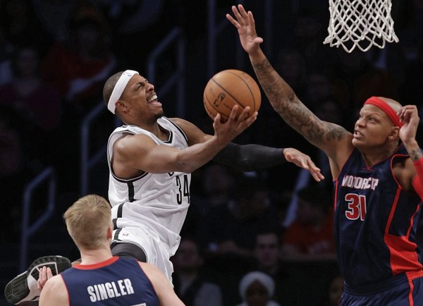 Detroit Pistons forward Charlie Villanueva (31) defends as Brooklyn Nets forward Paul Pierce (34) goes up for a layup in the second half of an NBA basketball game, Sunday, Nov. 24, 2013, in New York. The Pistons won 109-97. (AP Photo/Kathy Willens)