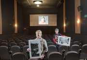 Peach Madl, owner of the The Plaza Grill and Cinema, left, and manager Peggy Armstrong, inside the theater, hold prints of old photographs that helped reveal the movie house to be the oldest operating cinema in America.