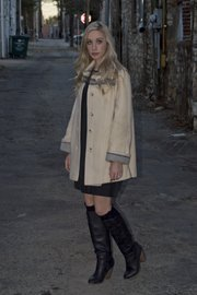 Emily Kennedy wears a coat ($18.50) and dress by Rachel Roy ($15), purchased at Arizona Trading Company.