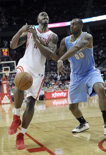 Denver Nuggets' Darrell Arthur (00) knocks the ball away from Houston Rockets' Terrence Jones in the second half of an NBA basketball game Saturday, Nov. 16, 2013, in Houston. The Rockets won 122-111. (AP Photo/Pat Sullivan)