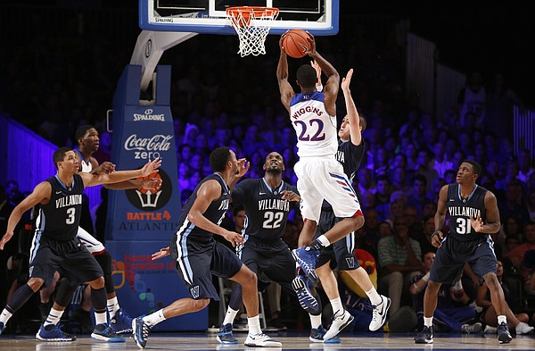 Kansas guard Andrew Wiggins hangs in the lane for a shot over the Villanova defense during the second half on Friday, Nov. 29, 2013 in Paradise Island, Bahamas.