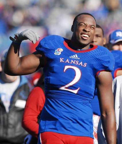 Kansas senior Darius Willis (2) reacts to a video of himself during a senior day recognition before the Jayhawks game against KSU Saturday at Memorial Stadium.