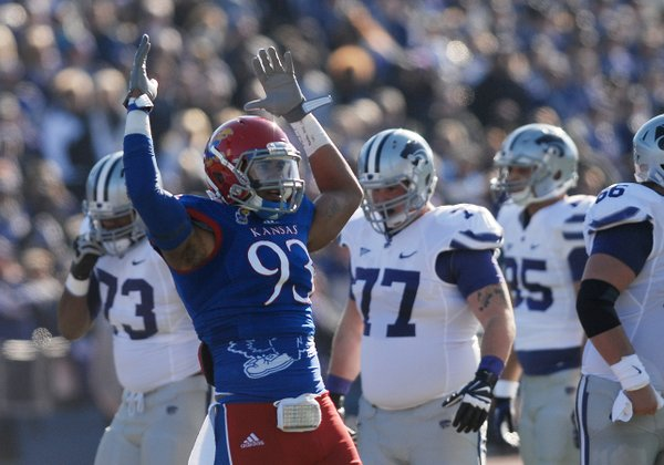 Kansas defender Ben Goodman (93) pumps his arms in the air to get the crowd into the game during the first-half of the Jayhawks game against KSU Saturday at Memorial Stadium.