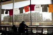 "Richard Gwin/Journal World Photo.The Willow Domestic Violence Center's Clothesline Project hangs in The  Underground"",  in KU's  Wesco Cafeteria, the display features domestic violence advocate and survivor art."
