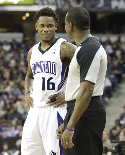 Sacramento Kings guard Ben McLemore talks with Official Sean Wright during the third quarter of an NBA basketball game against the Golden State Warriors in Sacramento, Calif., Sunday, Dec. 1, 2013. The Warriors won 115-113. (AP Photo/Rich Pedroncelli)