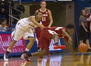 Unable to keep up with Arkansas' Keira Peak, Kansas' Asia Boyd (0) pulls her down during their game Wednesday night at Allen Fieldhouse.