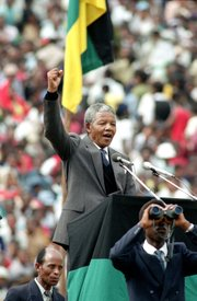 In this Feb. 13, 1990, file photo, African National Congress leader Nelson Mandela gives the black power salute to 120,000 ANC supporters packing Soccer City stadium in the Soweto township of Johannesburg, South Africa, shortly after his release from 27 years in prison. South Africa's president says, Thursday, Dec. 5, 2013, that Mandela has died. He was 95.