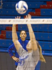 Kansas volleyball coach Ray Bechard watches his team run through drills during an open practice Thursday at Allen Fieldhouse. The Jayhawks open the NCAA tournament Friday against Wichita State.