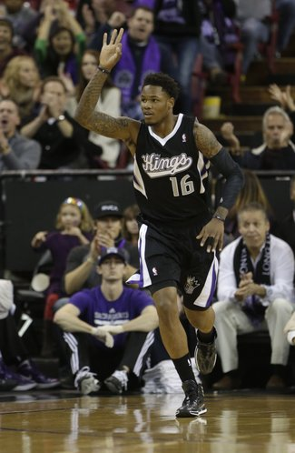 Sacramento Kings guard Ben McLemore flashes three fingers after scoring a three-point shot during the first quarter of an NBA basketball game against the Los Angeles Clippers in Sacramento, Calif., Friday, Nov. 29, 2013. (AP Photo/Rich Pedroncelli)