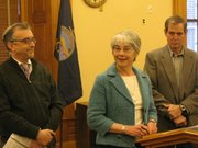 From left to right, Rabbi Moti Rieber, of Overland Park, state Sen. Marci Francisco, D-Lawrence, and Wayne White, a Jefferson County farmer, appear during a news conference Friday in the Statehouse on environmental issues.