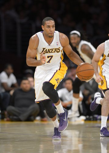 Los Angeles Lakers forward Xavier Henry dribble the ball during the first half of an NBA basketball game against the Sacramento Kings, Sunday, Nov. 24, 2013, in Los Angeles. (AP Photo/Mark J. Terrill)