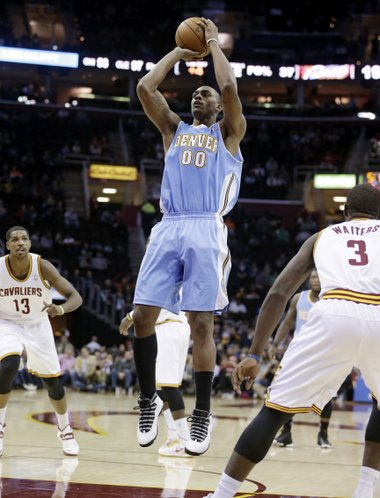 Denver Nuggets' Darrell Arthur (00) shoots against the Cleveland Cavaliers during an NBA basketball game Wednesday, Dec. 4, 2013, in Cleveland. (AP Photo/Tony Dejak)