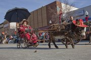 Cindy Walker of Lincoln, Neb., was a hit with her miniature donkey in the 21st annual Old-Fashioned Christmas Parade in downtown Lawrence.