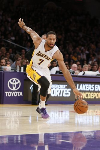 Los Angeles Lakers' Xavier Henry dribbles the ball during the NBA basketball game against the Toronto Raptors in Los Angeles, Sunday, Dec. 8, 2013. The Raptors won 106-94. (AP Photo/Danny Moloshok)