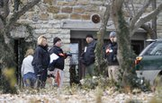 Police investigate a house at 837 Avalon on Monday, Dec. 9.