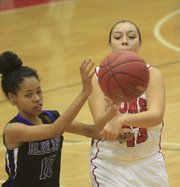 Lawrence's Jolona Shield (43) contests a shot by Junction City's Abryana Dixon on Tuesday, Dec. 10, 2013, at LHS.