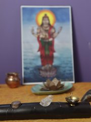 An altar with the image of Lord Dhanvantari, the god of health care and regarded as the source of Ayurveda, is displayed inside the studio space of Ayurveda practitioner Laura Martin-Eagles studio.