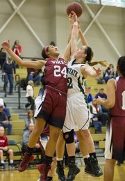 Free State senior Scout Wiebe, right, and Topeka Seaman's Tatyana Legette (24) fight for a rebound during their game Tuesday at FSHS.