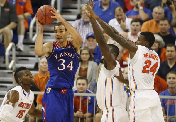 Kansas forward Perry Ellis is covered by the Florida defense during the first half on Tuesday, Dec. 10, 2013 at O'Connell Center in Gainesville, Florida.