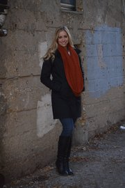 Elizabeth Kennedy wears a Patagonia black coat ($398.98) and Royal Robbins orange scarf (29.98) from Sunflower.