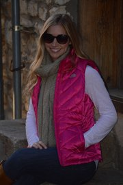 Elizabeth Kennedy sports a North Face pink vest ($98.98) and Royal Robbins scarf ($41.98), from Sunflower Outdoor and Bike Shop, 804 Massachusetts St.